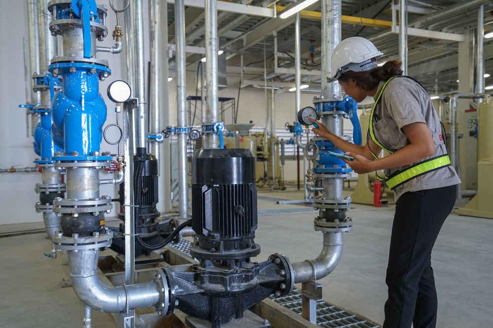 Mechanical Engineer Checking Compressor